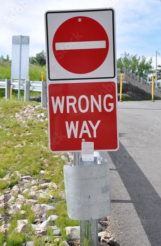 Wrong way signage posted on the road