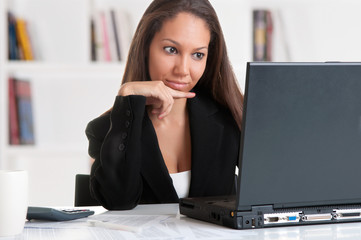 Businesswoman At Office Desk