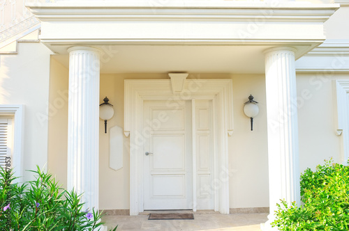 White front door of house with columns