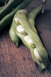 Broad Beans on a wooden Table