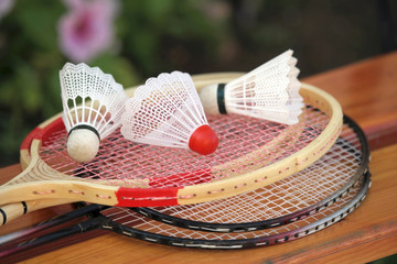 Badminton rackets and shuttlecocks.