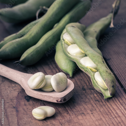 Broad Beans on a wooden Table with Spoon