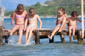 Little girls on the pier