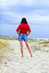 beauty with long hair on sea beach