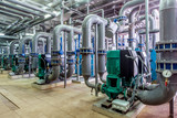 interior gas boiler room with multiple pipelines and pumps;