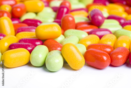 Pile of candy buttons isolated on white