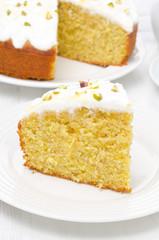 piece of orange cake with Greek yogurt, honey and pistachios