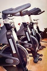 Group of spinning bicycles at fitness studio