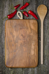 vintage cutting board with space for text, spoon, chili pepper