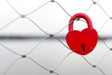 Red love padlock on bridge fence - wedding day tradition