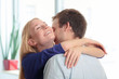 Young woman close her eyes and embracing her boyfriend