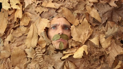 funny man under falling leavs, autumnal concept