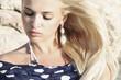 beautiful blond woman. stone.blue polka dot scarf