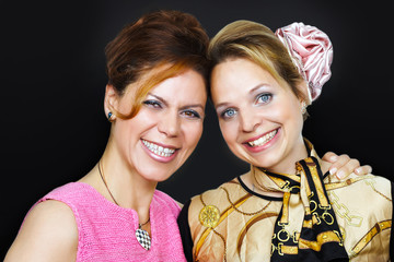 Happy friends, two cheerful smiling women