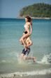 Couple running on a tropical beach. Vacation