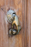 hand shaped door knocker