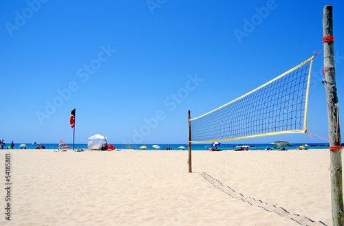 Beach Volleyball net on sandy beach