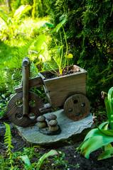 Decorative wooden flower pots in the garden