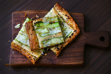 Zucchini galette cut in squares, crusty appetizer savory pastry