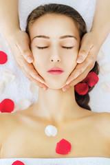 Woman receiving spa head massage