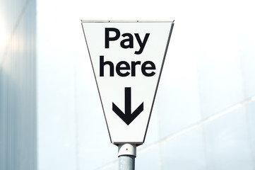 "Pay and display, ""Pay Here"" carpark sign"