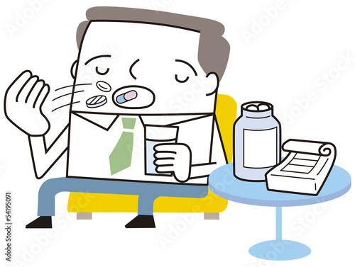 薬を飲むビジネスマン
