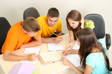 Group of young students sitting in the room