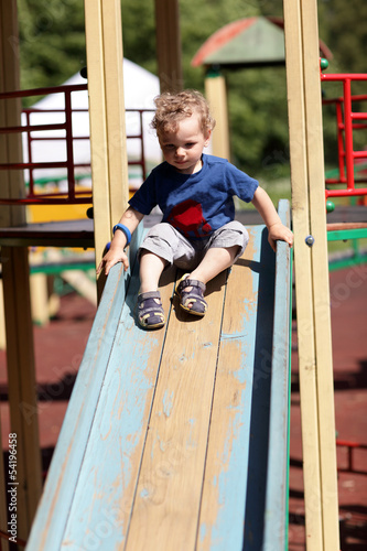 Toddler sliding on a slide
