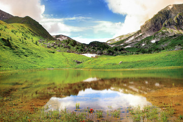 Beautiful mountain lake and alpine meadow