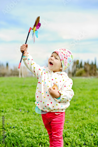 hapy girl with windmill