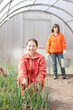 women works at greenhouse