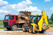 Wheel loader Excavator unloading sand into truck body