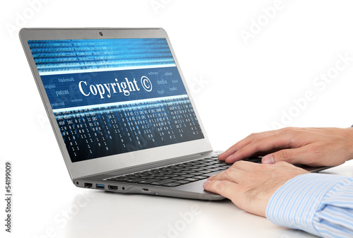 hands typing on laptop. Copyright message concept