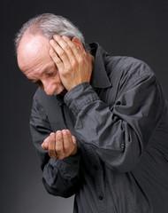 Man holding handful of pills