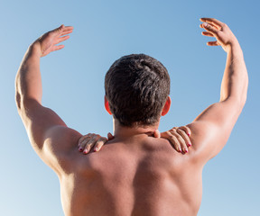 The man reaches for the sky on shoulders female hands