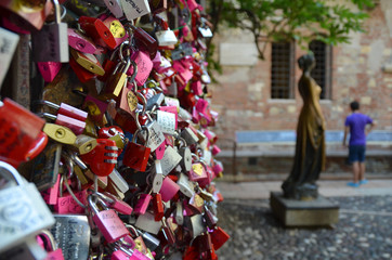 Love locks by a monument of Juliet