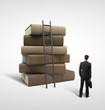businessman standing near stack of books