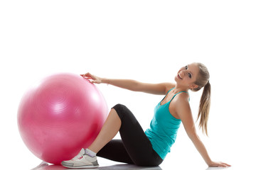 Image of cheerful young athlete posing with ball
