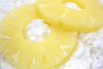 Close view pineapple sliced on cottage cheese