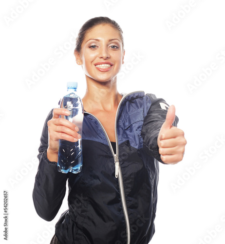 Smiling young sporty woman with water