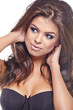 sensual brunette woman with shiny  silky hair studio shot
