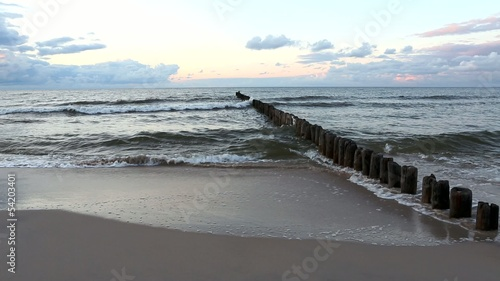 Baltic Sea and the breakwater at sunset