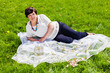 Lovely mature woman lying in the park