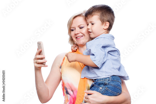 Mother holding son with smartphone