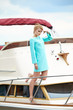 Elegant retro woman wear  dress , sitting near the wooden yacht.