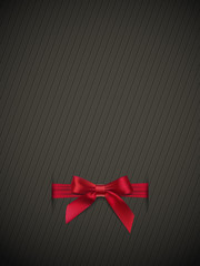 Textured background with a red bow
