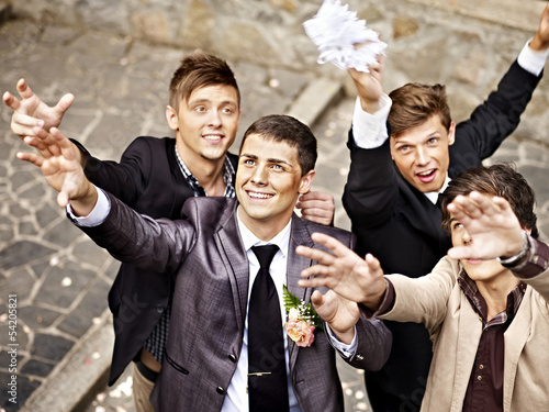 Group men catch  bride  garter
