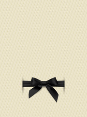 Textured background with a black bow