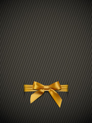 Textured background with a gold bow
