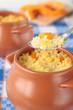 Spoon of millet porridge with sliced pumpkin